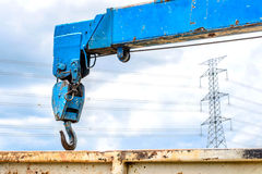 Metal hook for car towing and high voltage background Royalty Free Stock Image