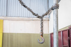 Metal hook hanging on chain Stock Photography