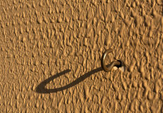 Metal hook on wall. Royalty Free Stock Image