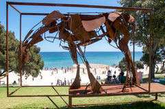 Metal Horse: Sculptures by the Sea, Cottesloe Beach. COTTESLOE,WA,AUSTRALIA-MARCH 12,2016: Elevated view through metal horse sculpture of people at the Royalty Free Stock Image