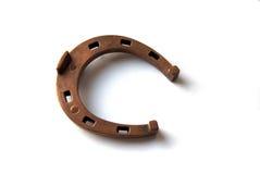 Metal horseshoe. Bronze decorative horseshoe on white Stock Photos