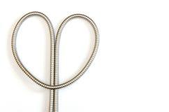 Metal hose heart Royalty Free Stock Image