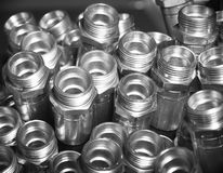 Metal hydraulic fittings stands on the silver table Stock Photography