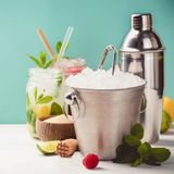 Metal ice bucket and fresh cocktails Royalty Free Stock Photo