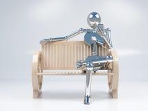Metal il telefono cellulare robot della tenuta del cromo a disposizione e la seduta Immagini Stock Libere da Diritti