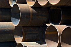 Metal industrial pipes. Stack of heavy industrial metal pipes stock photos