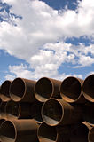 Metal industrial pipes. Stack of heavy industrial metal pipes royalty free stock images