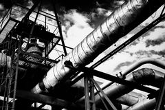 Metal industrial piping of a factory that carries water/gas/materials and met Royalty Free Stock Photo