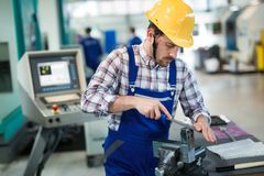 Metal industry factory worker working on metal parts Stock Images