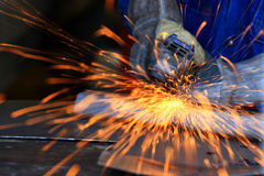 Metal industry worker grinding Stock Image