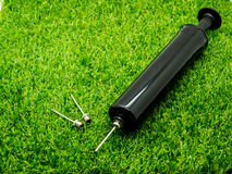 Metal inflation needle included heavy duty pump on the grass royalty free stock photography