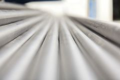 Metal inox pipe on stack. Close up stock photography