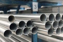 Metal inox pipe on stack. Close up Royalty Free Stock Photography