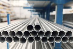 Metal inox pipe on stack. Close up Royalty Free Stock Image