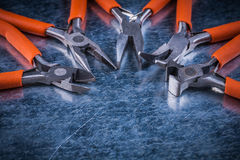 Metal insulated electric cutting pliers gripping tongs construction Royalty Free Stock Photo