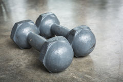Metal iron dumbbell on wood sport of fitness bodybuilding Stock Photos