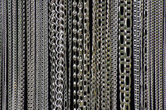 Silver jewelry chains background Royalty Free Stock Photography