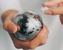 A metal jigsaw ball in a man's hands Stock Photography