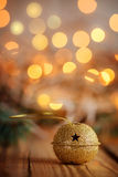 Metal Jingle Bell with star on Wooden Table. Christmas backgroun Royalty Free Stock Photos