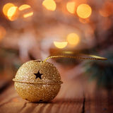 Metal Jingle Bell with star on Wooden Table Royalty Free Stock Images