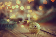 Metal Jingle Bell with star on Wooden Table. Christmas backgroun Royalty Free Stock Images