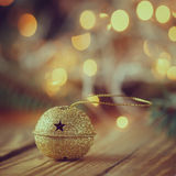 Metal Jingle Bell with star on Wooden Table. Christmas backgroun Stock Images