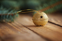 Metal Jingle Bell with star on Wooden Table Royalty Free Stock Photos