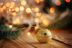 Metal Jingle Bell with star on Wooden Table Royalty Free Stock Photography