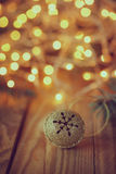 Metal Jingle Bell with star on Wooden Table. Retro Stock Photo