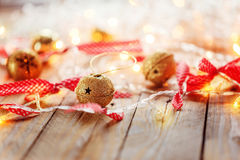 Metal Jingle Bells and Christmas Garland Light .  background Stock Image