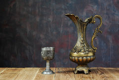 Metal jug and chalice Stock Photos