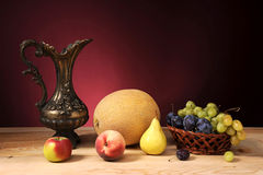 Metal jug and fruit Stock Photos