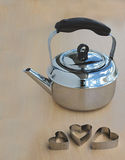 Metal Kettle and hearts. Metal Kettle and three hearts royalty free stock images