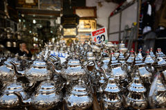 Metal kettles on display in Moroccan market Royalty Free Stock Images