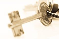Metal key. Closeup on white background Stock Image