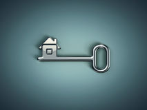 Metal key with abstract house Royalty Free Stock Images