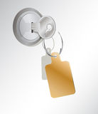 A metal key with an empty tag Stock Photo