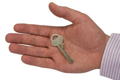 Metal key in hand Royalty Free Stock Image