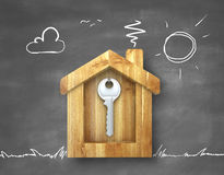 Metal key. Key hanging in a wooden house Royalty Free Stock Image