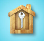Metal key. Hanging in a wooden house Stock Photos