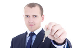 Metal key in male real estate agent hand isolated on white Royalty Free Stock Photo