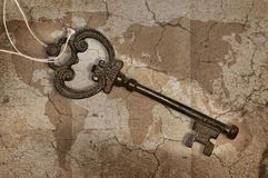 Metal key on map Stock Photo
