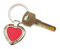 Metal key with red heart keychain on white Stock Photos