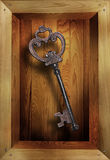 Metal key in wooden box Royalty Free Stock Photography