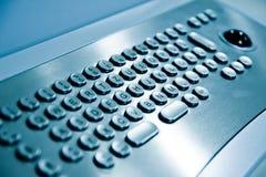 Metal keyboard. Of a public internet terminal royalty free stock photo