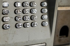 Metal keypad of public phone. Royalty Free Stock Image