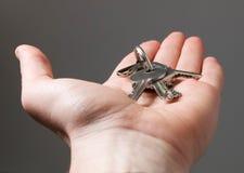 Metal keys on open hand Stock Photo