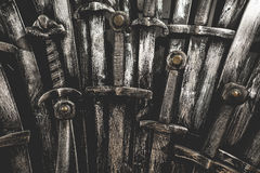 Metal knight swords background. Close up.