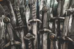 Metal knight swords background. The concept Knights. Royalty Free Stock Photos