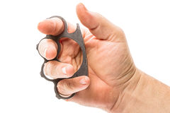 Metal knuckles in his hand Royalty Free Stock Photo
